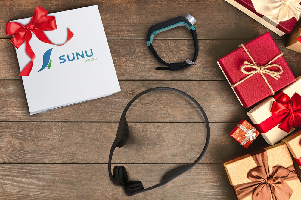 Sunu Band and Aftershokz next to a gift box
